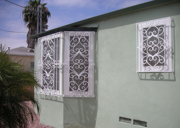 Ba ramirez iron works gallery wrought iron window guards for Window bars design